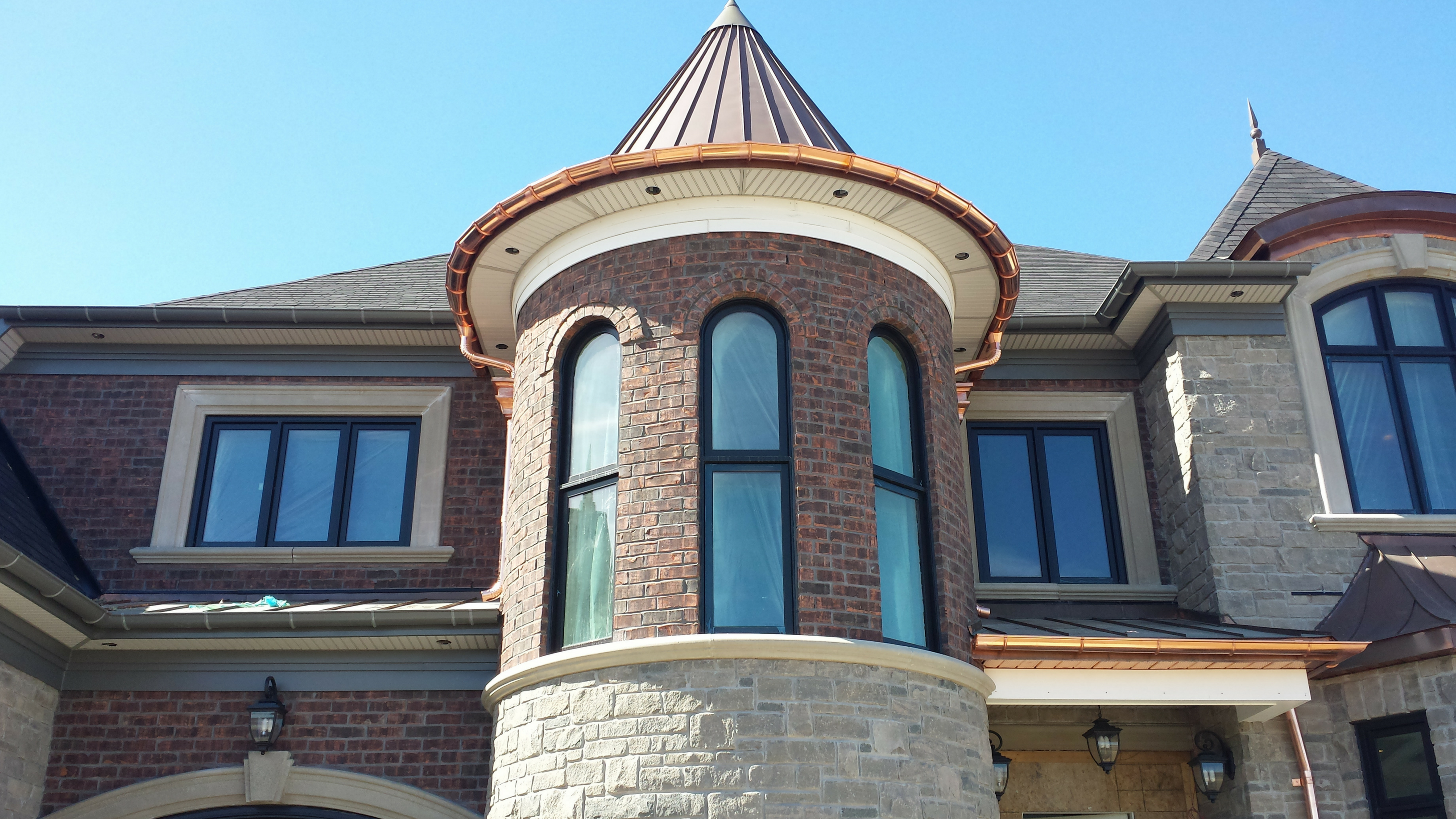 HALF ROUND – EURO STYLE ALUMINUM & COPPER GUTTERS